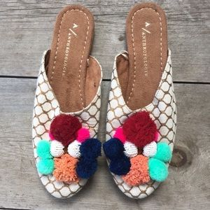 Anthropologie Pom Slip Ons (NWOT)